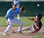 Alton's Nathan Lemons (right) slides safely into second base as Belleville East's Micah Georgian waits on the ball. Alton defeated Belleville East in a Class 4A regional semifinal at Alton High School in Alton, IL on Thursday May 23, 2019.<br /> Tim Vizer/Special to STLhighschoolsports.com