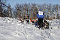 Saturday, February 24th, Knik, Alaska.  Jr. Iditarod musher Rohn Buser  on the trail shortly after leaving the Knik start