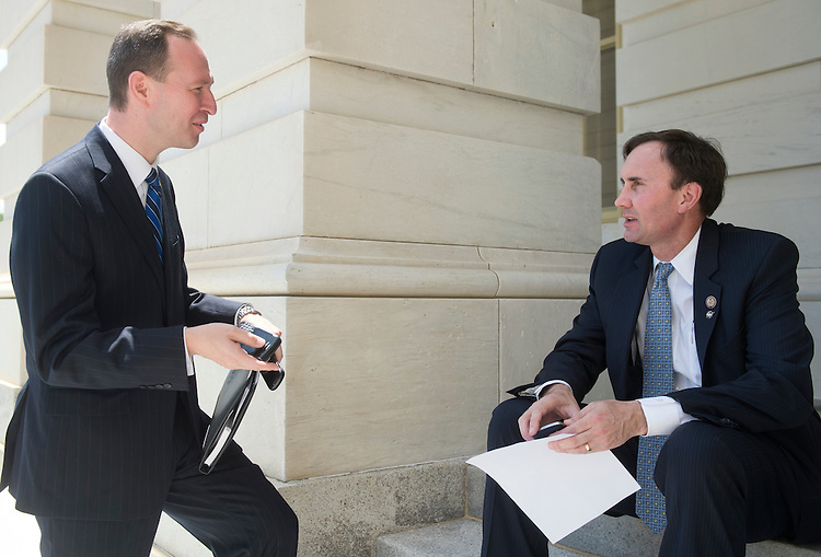 UNITED STATES - MAY 18: JT Jezierski, Mitt Romney's top Hill liaison, speaks with his former boss, Rep. Pete Olson, R-Texas, outside of the Capitol following the final vote of the week on Friday, May 18, 2012. (Photo By Bill Clark/CQ Roll Call)