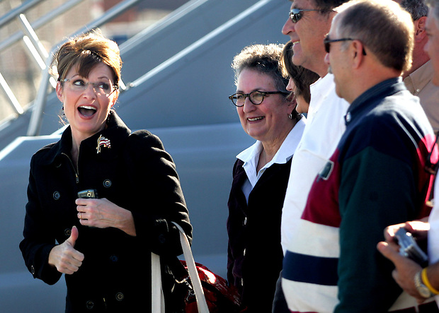 Republican vice presidential candidate, Alaska Gov. Sarah Palin, bids farewell to supporters at the Des Moines International Airport following a campaign rally in Des Moines, Iowa Saturday, October 25, 2008.