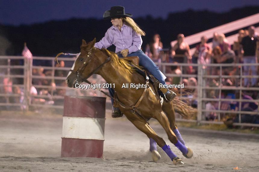 Johnsville, MD: J Bar W Ranch -- Julie Stoval rounding first barrel.