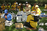 LARGE NUMBER of FALUN GONG MEMBERS SIT and PRAY on the PARK at DENVER.<br />