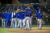 AZL Cubs left fielder Nelson Velazquez (20) is congratulated by teammates after hitting a ninth inning home run against the AZL Giants on September 5, 2017 at Scottsdale Stadium in Scottsdale, Arizona. AZL Cubs defeated the AZL Giants 10-4 to take a 1-0 lead in the Arizona League Championship Series. (Zachary Lucy/Four Seam Images)