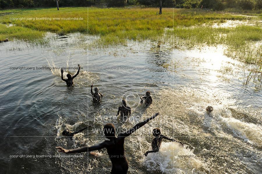 SOUTH SUDAN Lakes state, Rumbek, children bath in swamp / SUED SUDAN, Kinder baden im Sumpf
