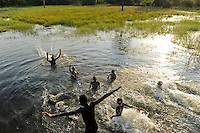 SOUTH SUDAN Lakes state, Rumbek, children bath in swamp / SUED SUDAN, Kinder baden im Sumpf