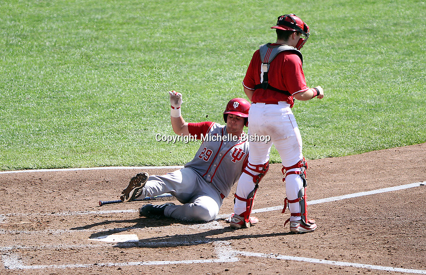 Ryan Fineman scores Indiana's first run of the game in the fourth inning. Indiana's 6-2 win eliminated Nebraska from the Big Ten Tournament at TD Ameritrade Park in Omaha, Neb. on May 26, 2016. (Photo by Michelle Bishop)