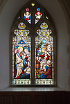 Stained glass window in church of Saint Michael, Peasenhall, Suffolk, England, UK circa 1868 by Ward and Huges two panels Jesus Christ Healing the sick and Suffer the Little Children