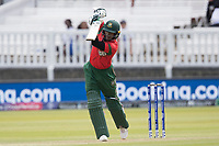Shakib Al Hasan (Bangladesh) drives straight down the ground for four runs during Pakistan vs Bangladesh, ICC World Cup Cricket at Lord's Cricket Ground on 5th July 2019