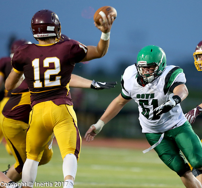 HARRISBURG, SD - AUGUST 25: Pierre's Jacob Beastrom #61 applies pressure as Harrisburg quarterback Hunter Headlee #12 passes the ball in the first half of their game Friday night at Harrisburg. (Photo by Dave Eggen/Inertia)