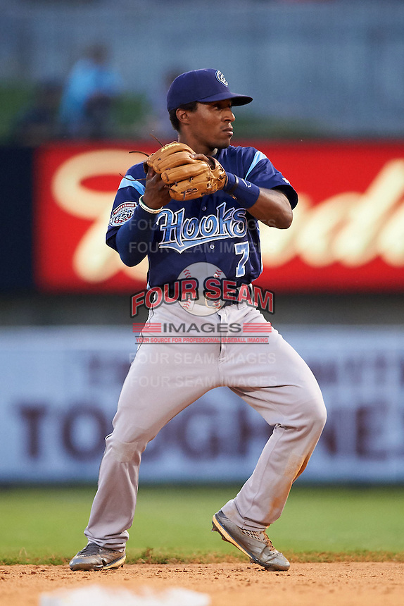 Corpus Christi Hooks second baseman Tony Kemp (7) throws to first after fielding a ground ball during a game against the Arkansas Travelers on May 29, 2015 at Dickey-Stephens Park in Little Rock, Arkansas.  Corpus Christi defeated Arkansas 4-0 in a rain shortened game.  (Mike Janes/Four Seam Images)
