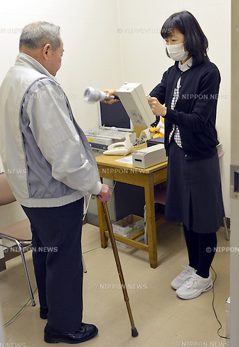 February 27, 2013, Fukushima, Japan - A patient has his radiation dosage checked at the Japan Red Cross hospital in Fukushima, some 290 km northeast of Tokyo, on February 27, 2013. Almost two years have past since the meltdown of nuclear reactors at Fukushima No. 1 power plant following the March 11, 2011, earthquake and tsunami, out of fear of radiation exposure some 40 to 50 citizens visit the hospital daily to check their radiation dosage.  (Photo by Natsuki Sakai/AFLO)
