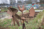 Rusty iron weather vane in allotment garden, Shottisham, Suffolk, England