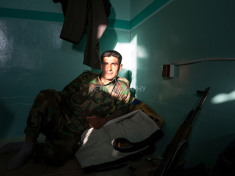 14/08/14  Iraq -- Daquq, Iraq -- A portrait of a peshmerga at  the base in Daquq.