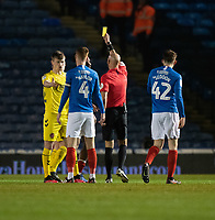Referee Darren Drysdale giving a yellow card to  to Fleetwood Town's Glenn Whelan for a foul on Portsmouth's Ryan Williams<br /> <br /> Photographer David Horton/CameraSport<br /> <br /> The EFL Sky Bet League One - Portsmouth v Fleetwood Town - Tuesday 10th March 2020 - Fratton Park - Portsmouth<br /> <br /> World Copyright © 2020 CameraSport. All rights reserved. 43 Linden Ave. Countesthorpe. Leicester. England. LE8 5PG - Tel: +44 (0) 116 277 4147 - admin@camerasport.com - www.camerasport.com