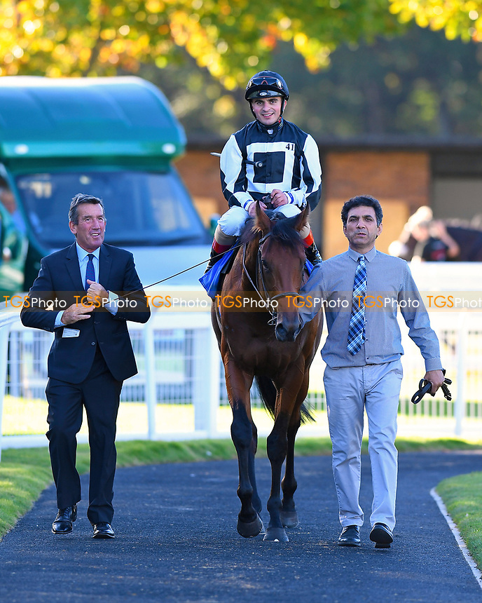 Winner of The Weatherbys General Stud Book Handicap Stakes Helvetian ridden by Andrea Atzeni and trained by Mick Channon  is led into the winners enclosure during Afternoon Racing at Salisbury Racecourse on 3rd October 2018