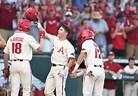 NWA Democrat-Gazette/J.T. WAMPLER Arkansas' Carson Shaddy gets met at home plate after hitting a first inning home run against South Carolina Monday June 11, 2018 during the NCAA Super Regional at Baum Stadium in Fayetteville.