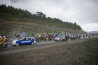 The stage will be continued neutralised over the slippery roads until weather (and road) conditions get better<br /> Riders gather to start riding again after the race was stopped for about half an hour.<br /> <br /> Tour of Turkey 2014<br /> stage 4