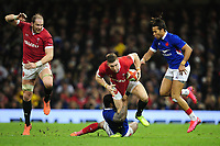Josh Adams of Wales is tackled by Virimi Vakatawa of France during the Guinness Six Nations Championship Round 3 match between Wales and France at the Principality Stadium in Cardiff, Wales, UK. Saturday 22 February 2020