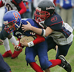 East Manatee Bulldog Evan Grafton (40) drags down Hacienda-La Puinte's Alfred Garcia (20) during the Pop Warner Super Bowl at Disney's Wide World of Sports complex in Orlando, FL, Friday, Dec. 9, 2005.(AP Photo/Brian Myrick)