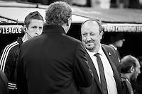 Paris Saint Germain's coach Laurent Blanc and Real Madrid coach Rafa Benitez