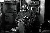 Hrubieszow,  South East Poland November 2005<br /> The faces of Polish poverty<br /> Unemployed man by the stove at the shelter for the poor and homeless in Hrubieszow <br /> ( &Scaron; Filip Cwik / Napo Images for Newsweek Polska)<br /> <br /> Hrubieszow k.Zamoscia 26 listopad 2005 Polska<br /> Oblicza biedy w Polsce<br /> Stowarzyszenie Przeciwdzialania Patologiom Spolecznym KRES prowadzi Ryszard Karpinski ktory wraz z czworka dzieci i zona mieszka w osrodku. Przebywa w nim 30 osob doroslych i 13 dzieci. Osrodek pobiera oplate w wysokosci 35 % przychodow mieszkanca /z emerytury , renty , zapomogi itp. /. Oferuje w zamian trzy cieple posilki dziennie, pokoj i ciepla wode.<br /> Wiekszosc Polakow niemal / 85% / z trudem radzi sobie z przezyciem od pierwszego do pierwszego. Ponad polowa / 52,5% / zalega ponad trzy miesiace z czynszem. Tyle samo osob, aby poprawic swoja sytuacje materialna radykalnie ogranicza wydatki. W beznadziejnej sytuacji jest ludnosc wiejska gdzie 18,5% zyje w skrajnej nedzy. W 1991 roku rzad polski zlikwidowal Panstwowe Gospodarstwa Rolne ktore od II Wojny Swiatowej byly miejscem pracy dla ponad 2 mln rolnikow glownie na ziemiach odzyskanych. Ci ludzie i ich rodziny nie odnalezli sie w nowej rzeczywistosci<br /> ( &Scaron; Filip Cwik / Napo Images dla Newsweek Polska)