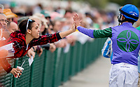 OLDSMAR, FL - MARCH 10: Jockey John Velazquez gives a fan a high five after a race on Tampa Derby Day at Tampa Bay Downs on March 10, 2018 in Oldsmar, FL. (Photo by Scott Serio/Eclipse Sportswire/Getty Images)