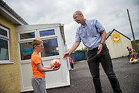 Friday  12 August 2016<br /> Pictured:  Amazon manager Pat Faulkner with  one of the Carmarthen Breakthro children Ethan Williams  Re: The Amazon team in Swansea has made a recent donation of £1,000 to Carmarthen Breakthro charity. The Amazon team are visited the charity to learn more about what they do and how they plan to use the money.