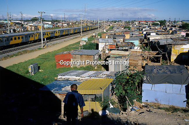 A commuter train leaves Nonqubela train station for Cape Town on August 20, 2001 in Site B Khayelitsha, a township outside Cape Town, South Africa. Khayelitsha is one of the poorest and fastest growing townships in South Africa. People usually come from the rural areas in Eastern Cape province to find work as maids and laborers. Most people don't find work and the unemployment rate is very high. (Photo by: Per-Anders Pettersson).