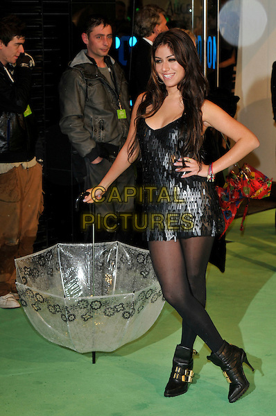 GABRIELLA CILMI.Royal World Film Premiere of 'Alice in Wonderland' at the Odeon cinema, Leicester Square, London, England, UK,.25th February 2010.arrivals full length holding umbrella raining flowers black mini dress tights hand on hip ankle boots paillettes sequined layered sequin sleeveless gold buckles .CAP/PL.©Phil Loftus/Capital Pictures