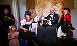 Winners of the Scallywaggers Pirate Pup Parade and costume contest pose for photos at the Brewery Arts Center, in Carson City, Nev., on Wednesday, Sept. 18, 2019. From left, Peggy Naegeli, Jules Lawson, 4, CASI founder Lisa Schuette, Crew Favorite winner Butters, Zoe New, 9, Best Captain winner Stitch, pirate Gerard Reyes, Carson City Classic Cinema Club founder Rhonda Abend and Best First Mate winner Gunner. The event, part of the ongoing Summer Movie Night hosted by the cinema club and Realtor Garrett Lepire, benefits CASI. <br /> Photo by Cathleen Allison/Nevada Momentum
