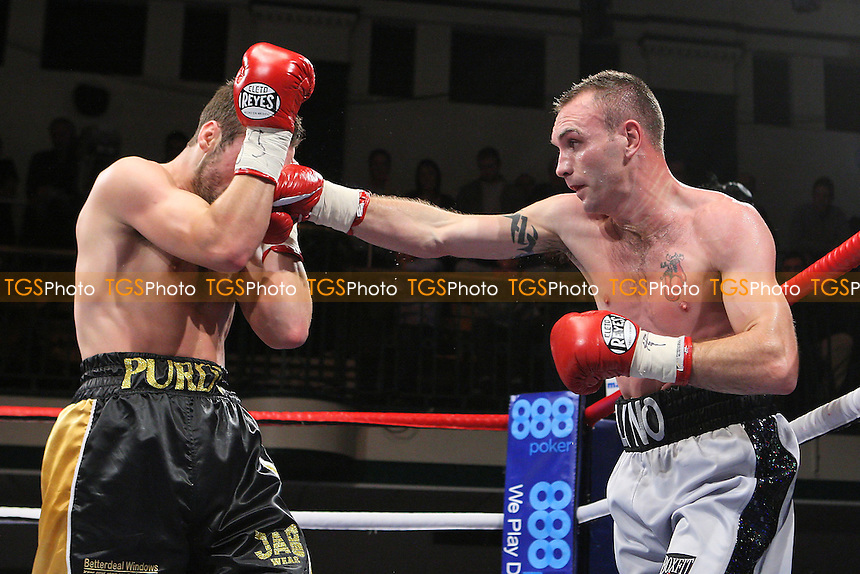 Colin Lynes (silver/black shorts) defeats Lee Purdy in a Welterweight boxing contest for the British Title at York Hall, Bethnal Green, promoted by Matchroom Sports - 09/11/11 - MANDATORY CREDIT: Gavin Ellis/TGSPHOTO - Self billing applies where appropriate - 0845 094 6026 - contact@tgsphoto.co.uk - NO UNPAID USE.