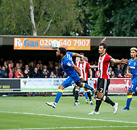 AFC Wimbledon's Andy Barcham just misses a header  during the Carabao Cup match between AFC Wimbledon and Brentford at the Cherry Red Records Stadium, Kingston, England on 8 August 2017. Photo by Carlton Myrie.