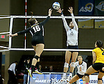 SIOUX FALLS, SD - DECEMBER 8:  Kasey Williams #15 from Concordia St. Paul tries for a block on Annie Boele #16 from American International during their quarterfinal match at the Women's DII Volleyball Championships at the Sanford Pentagon in Sioux Falls, SD. (Photo by Dave Eggen/Inertia)