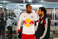 Thierry Henry (14) of the New York Red Bulls talks with Dwayne De Rosario (7) of D. C. United during a snow delay  prior to playing the the second leg of the MLS Eastern Conference Semifinals at Red Bull Arena in Harrison, NJ, on November 7, 2012.