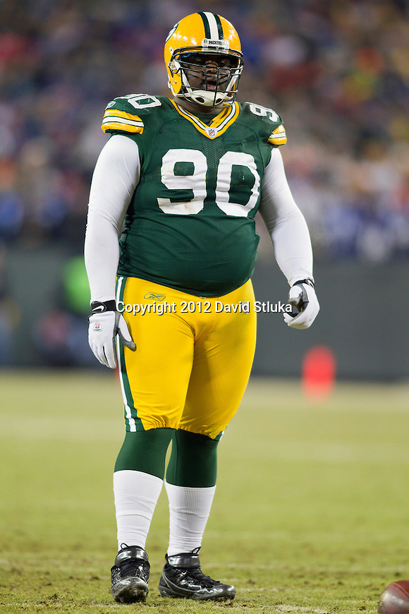 Green Bay Packers defensive lineman B.J. Raji (90) looks on during an NFL divisional playoff football game against the New York Giants on January 15, 2012 in Green Bay, Wisconsin. The Giants won 37-20. (AP Photo/David Stluka)