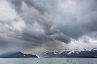 Landscape of low lying clouds over the Chugach National Forest in College Fjord, Prince William Sound, Alaska.