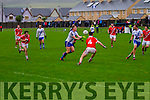 St Mary's Denis Daly with a well timed offload to the advancing run of Paul O'Donoghue in a very convincing performance from the local side in the Munster Semi-Final in Cahersiveen on Saturday.