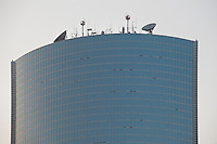 Daytime landscape detailed view of communication antenna on top of a commercial building in D?ngchéng Q? in Beijing.  © LAN