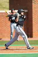 Connor Owings (6) of the Coastal Carolina Chanticleers follows through on his swing against the High Point Panthers at Willard Stadium on March 15, 2014 in High Point, North Carolina.  The Chanticleers defeated the Panthers 1-0 in the first game of a double-header.  (Brian Westerholt/Four Seam Images)
