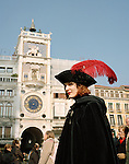 Woman in costume at Carnival, St Marks Square,  Venice, Italy