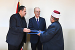 Palestinian Prime Minister, Rami Hamdallah, attends the signing of a memorandum of understanding for the operation and development of the vocational education school complex in Jerusalem, in the West Bank city of Ramallah, on March 12, 2019. Photo by Prime Minister Office
