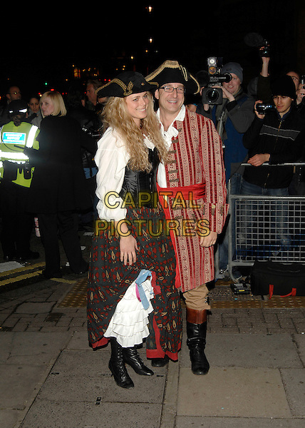 PAUL McKENNA & GUEST.Arrives at the fancy dress party reception for Matt Lucas & Kevin McGee following their civil partnership ceremony (wedding) earlier the same day,.Banquetting House, Whitehall, London, England,.17th December 2006..full length funny costume hat .CAP/PL.©Phil Loftus/Capital Pictures