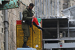 Israeli security forces take position as Palestinian demonstrators take part in a protest to mark the third anniversary of the killing of Palestinian Abdulfattah Shareef by Israeli soldiers in the West Bank city of Hebron, on March 24, 2019. Shareef was shoot dead by Israeli soldiers after he stabbed a soldier in Hebron, army said, a video taken by an activist shows an Israeli soldiers shoots Shareef in head as he was laying on the ground injured and neutralized. Photo by Wisam Hashlamoun