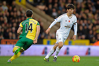 Ki Sung-yueng of Swansea City runs past Wes Hoolahan of Norwich City during the Barclays Premier League match between Norwich City and Swansea City played at Carrow Road, Norwich on November 7th 2015