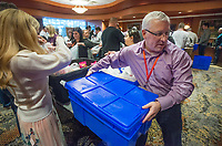NWA Democrat-Gazette/BEN GOFF @NWABENGOFF<br /> Sean Madden, a Tyson employee from Pittsburgh, helps fill containers with snack packs Wednesday, Dec. 5, 2018, at Embassy Suites Northwest Arkansas in Rogers. More than 800 Tyson employees from across the country who are in town this week attending the company's annual sales conference took the afternoon to pack and load food donations. The employees helped distribute 35,000 pounds of Tyson products to Northwest Arkansas organizations with feeding services and food banks. In addition 1,000 meal boxes, 15,000 snack packs and personal hygiene kits were packaged and distributed to Northwest Arkansas non-proffits.