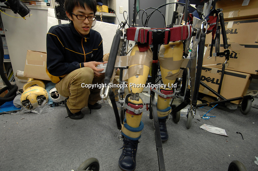 "A reasearcher with the ""Active Walker"" at the Department of Mechanical Engineering, Tokyo University of Science. The Active Walker is a suit that will enable children who are disabled and unable to use leg muscles to walk."