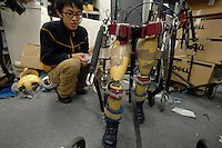 """A reasearcher with the """"Active Walker"""" at the Department of Mechanical Engineering, Tokyo University of Science. The Active Walker is a suit that will enable children who are disabled and unable to use leg muscles to walk."""