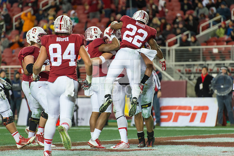 SANTA CLARA, CA - DECEMBER 30, 2014: The team celebrates during Stanford's game against Maryland in the 2014 Foster Farms Bowl.  The Cardinal defeated the Terrapins 45-21.