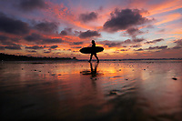 December 23, 2018 - San Diego, California, USA - A female surfer walks out of the water during a low tide at sunset at La Jolla Shores Beach.   (Photo Credit: © K.C. ALFRED/ZUMA PRESS)