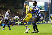 (L-R) Andre Ayew of Swansea City is challenged by Dominic Iorfa of Sheffield Wednesday during the Sky Bet Championship match between Sheffield Wednesday and Swansea City at Hillsborough Stadium, Sheffield, England, UK. Saturday 09 November 2019
